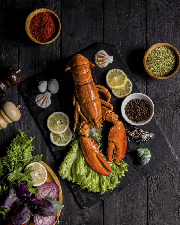 roasted lobster served with vegetables lemon